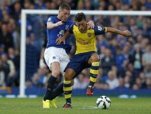 Arsenal puanı son dakikada aldı!